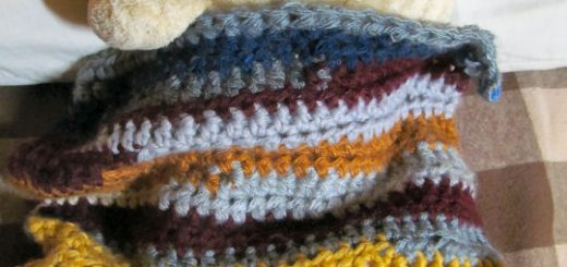 Want to use up scrap yarn? Make a scrapghan for your kids' dolls. Make a mtaching blanket when you crochet a blanket for a child. Read more on Sakeenah.com