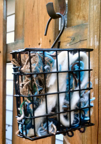 Easy yarn craft project - Fill a suet feeder with yarn scraps for birds to use as nesting material | Sakeenah.com